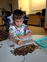 Counting pennies donated to UNICEF
